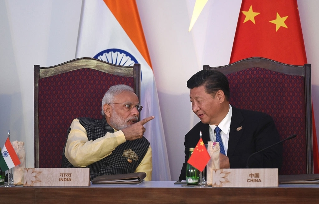Prime Minister Narendra Modi (L) gestures while talking with China's President Xi Jingping during the BRICS leaders' meeting (PRAKASH SINGH/AFP/Getty Images)