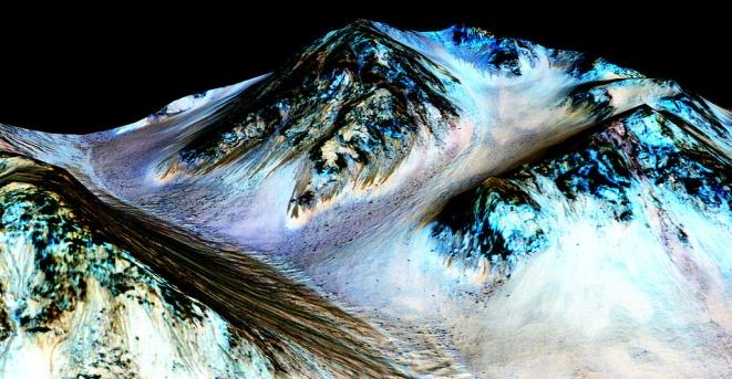 In this handout provided by NASA's Mars Reconnaissance Orbiter, dark, narrow streaks on the slopes of Hale Crater are inferred to be formed by seasonal flow of water on surface of present-day Mars. Photo credit: NASA/JPL-Caltech/Univ of Arizona via Getty Images
