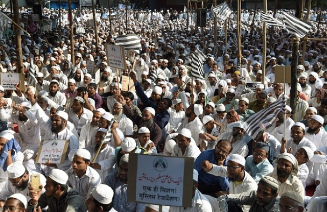 Indian Muslims take part in a protest rally against the implementation of a Uniform Civil Code in Mumbai on 20 October 2016. Photo credit: PUNIT PARANJPE/AFP/GettyImages