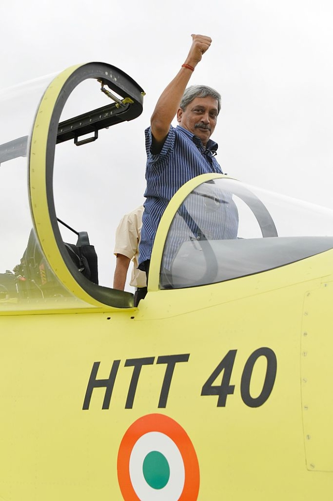 Indian Defense Minister Manohar Parrikar poses for a photograph  from the cockpit of a Hindustan Turbo Trainer-40 (HTT-40) aircraft  developed by Hindustan Aeronautics Limited. (MANJUNATH KIRAN/AFP/Getty Images)