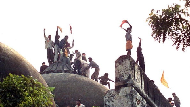 Kar sevaks atop the disputed structure (DOUGLAS E. CURRAN/AFP/Getty Images)