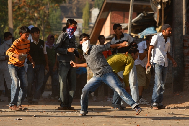 Youngsters pelting stones at the Army in the Kashmir Valley (Paula Bronstein/Getty Images)