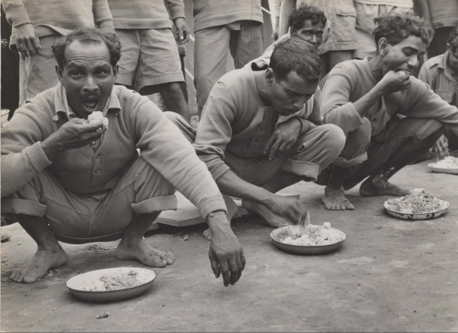 Chabua, Assam, India, April 1944,  Indian air freight workers eating rice.(Photo courtesy: Army Air Forces, Air Transport Command, Overseas Technical Unit, Washington DC)