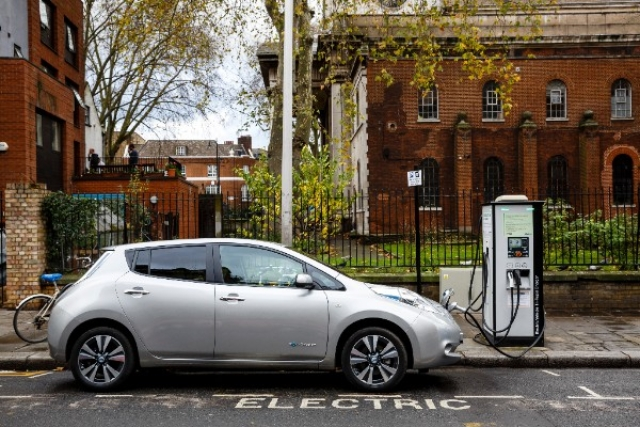 A Nissan Leaf charging at a public charging point (Miles Willis/Stringer)