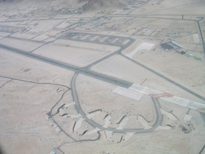 An aerial view of the Leh airfield showing aircraft shelters
