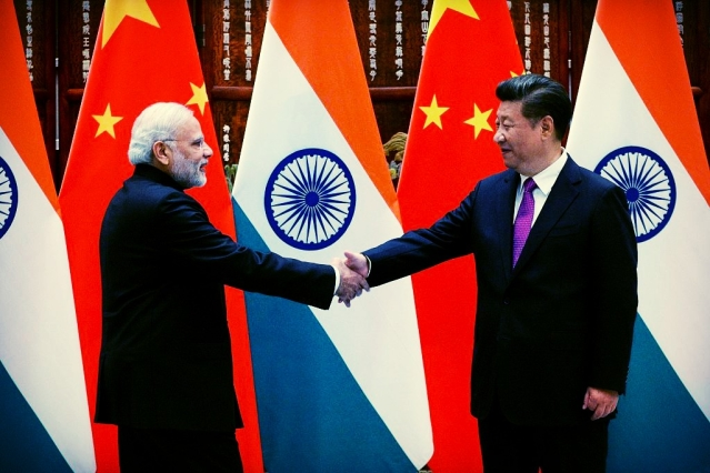 Prime Minister Narendra Modi (L) shakes hands with Chinese President Xi Jinping (R) at the West Lake State Guest House in Hangzhou on September 4, 2016. (WANG ZHAO/AFP/Getty Images)