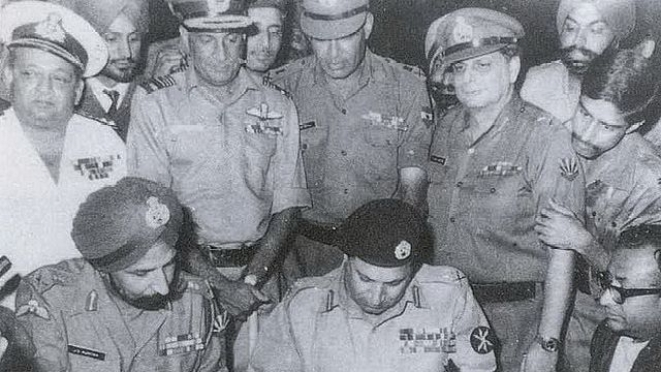 Lt Gen Niazi signing the Instrument of Surrender on behalf of Pakistan in 1971 (Indian Navy. Wikimedia Commons)