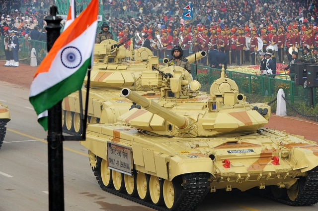 Indian military personnel drive Indian Army tanks as they take part in the Republic Day parade in New Delhi on January 26, 2014. (RAVEENDRAN/AFP/Getty Images)