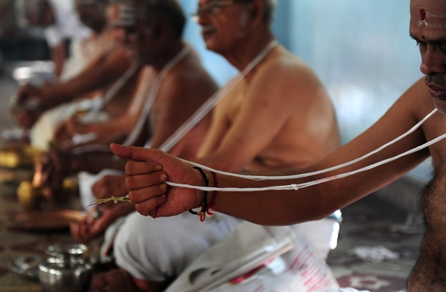 Brahmin community members perform a ritual on the occasion of 'Aavani Avittam' in Chennai. (ARUN SANKAR/AFP/GettyImages)
