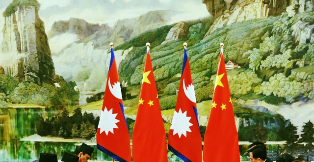 Nepal and Chinese flags (Lintao Zhang/Pool/GettyImages)