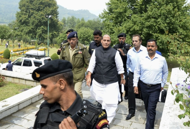 India's Home Minister Rajnath Singh walks before a press conference in Srinagar on September 11, 2017. Singh is on a four-day visit to Jammu and Kashmir. Several rebel groups have spent decades fighting Indian soldiers deployed in the disputed territory, demanding independence or a merger with Pakistan, which also claims the Himalayan region in its entirety. (TAUSEEF MUSTAFA/AFP/Getty Images)