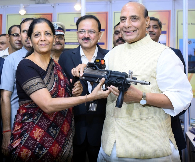 Defence Minister Nirmala Sitharaman and Home Minister Rajnath Singh having a feel of carbine indigenously produced by Ordnance Factory handed over to paramilitary forces for user trials at the DRDO Bhawan in New Delhi, India. (Arun Sharma/Hindustan Times via GettyImages)