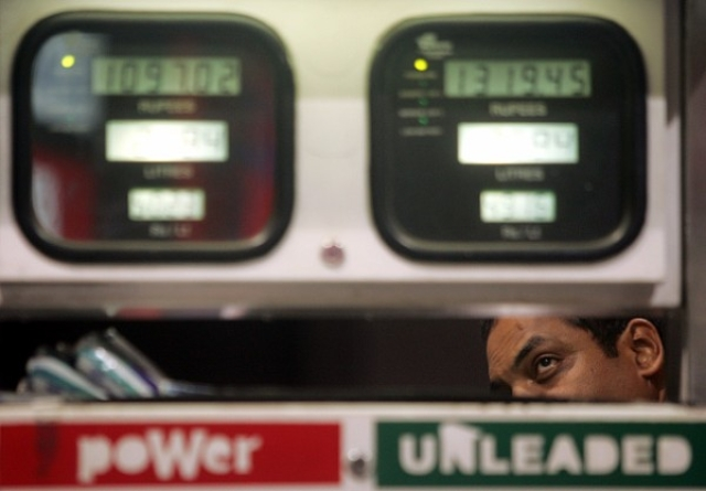 A car owner takes a close look at the metre at a petrol pump. (Manoj Patil/Hindustan Times via Getty Images)