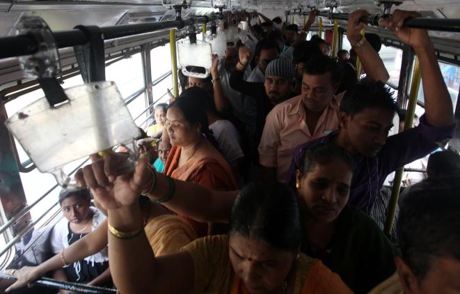 Women wade through a crowded bus (Anshuman Poyrekar/Hindustan Times via Getty Images)