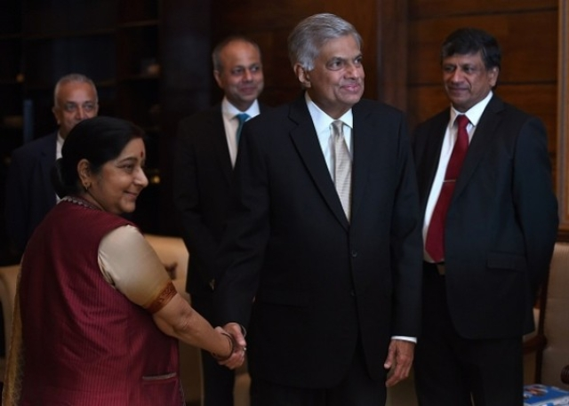 Sri Lanka's Prime Minister Ranil Wickremesinghe shakes hands with Foreign Minister Sushma Swaraj (L) during the opening of the two-day Indian Ocean Conference 2017 in Colombo. (ISHARA S. KODIKARA/AFP/Getty Images)