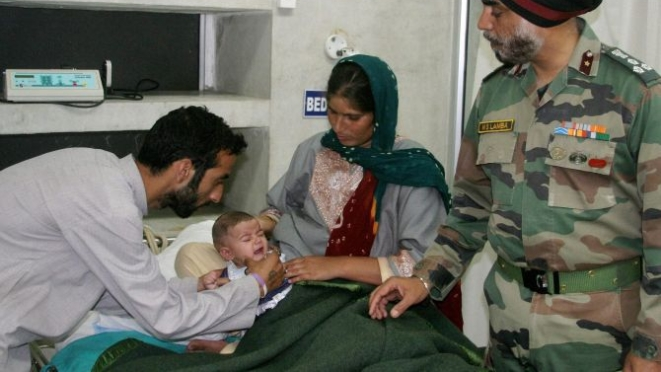 A soldier's infant receives medical care.