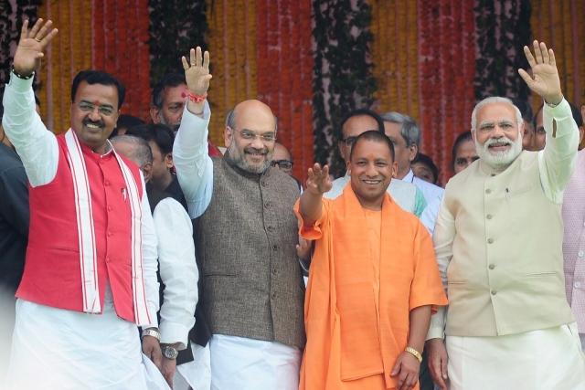 Chief Minister of Uttar Pradesh state Yogi Adityanath (C),  Prime Minister Narendra Modi (R), Bharatiya Janata Party (BJP) president Amit Shah and new deputy chief minister of Uttar Pradesh Keshav Prasad Maurya (L)(Sanjay Kanojia/AFP/Getty Images)