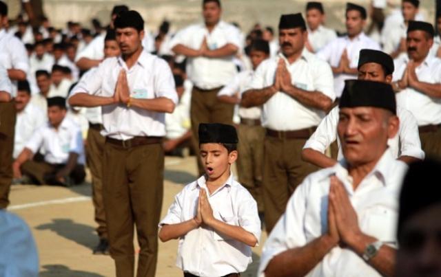 RSS volunteers performing yoga (Nitin Kanotra/Hindustan Times via Getty Images)