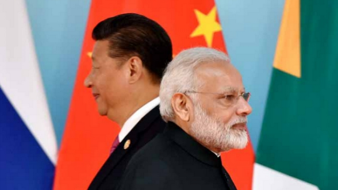 Xi Jinping and Narendra Modi attend the group photo session during the BRICS Summit at the Xiamen. (KENZABURO FUKUHARA/AFP/Getty Images)