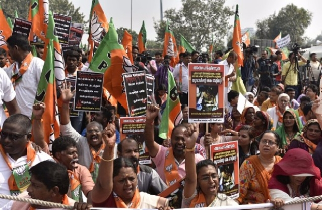 BJP supporters shout slogans during a 'Jana Raksha Yatra' from Central Park to CPI-M office in New Delhi, India. (Vipin Kumar/Hindustan Times via Getty Images)
