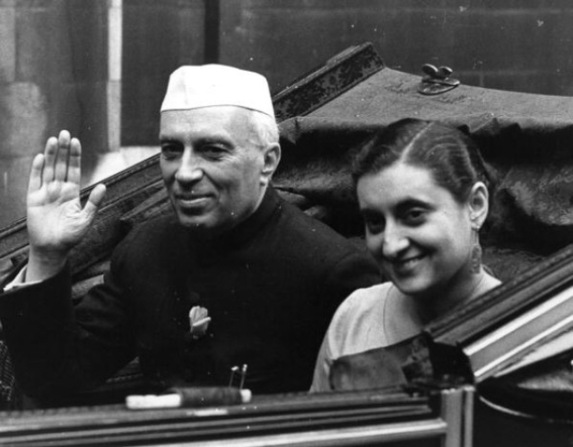 India's first prime minister Jawaharlal Nehru (1869-1964), with his daughter Indira Gandhi (born Indira Priyardarshini Nehru, 1917-1984), the future prime minister. (Monty Fresco/Topical Press Agency/Getty Images)