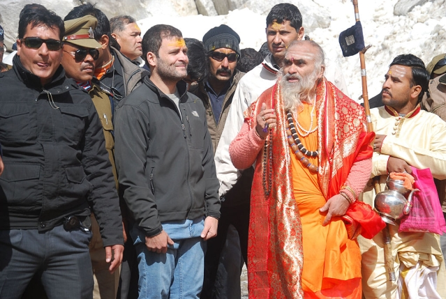 Congress Vice President Rahul Gandhi with the head priest Bheemashankar Ling at Kedarnath shrine on April 24, 2015 at Kedarnath (Vinay Santosh Kumar/Hindustan Times via Getty Images)