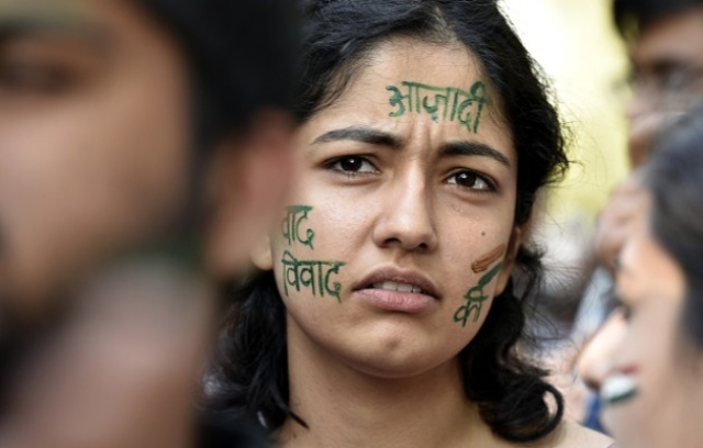 A student's <i>azadi</i> word paint on her face during the citizens protest march in New Delhi. (Raj K Raj/Hindustan Times via Getty Images)