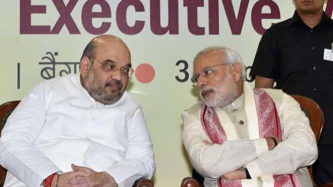 <p>Amit Shah and Narendra Modi</p>