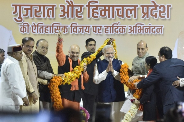 BJP leaders felicitating Prime Minister Narendra Modi and party president Amit Shah after Gujarat and Himachal Pradesh victories in New Delhi. (Sonu Mehta/Hindustan Times via Getty Images)