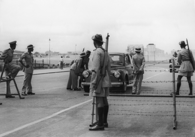Police at a special roadblock, set up during the parliamentary debate on the Tamil Languages Bill, in Columbo, Sri Lanka, 11 August 1958. (Keystone/Hulton Archive/Getty Images)