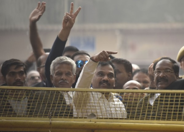 DMK leader and former union telecom minister A Raja with his supporters celebrating after the 2G case verdict. (Sonu Mehta/Hindustan Times via Getty Images)