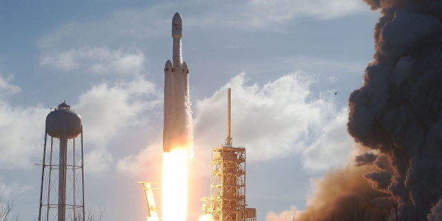 SpaceX's Falcon Heavy, World's Most Powerful Rocket, Soars Towards Mars